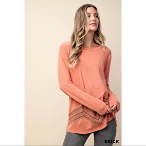 Bella - Long sleeve top with lace detail. Brick.